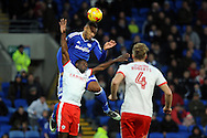 Cardiff City's Kenneth Zohore (c) beats Barnsley's Andy Yiadom to a header. EFL Skybet championship match, Cardiff city v Barnsley at the Cardiff city stadium in Cardiff, South Wales on Saturday 17th December 2016.<br /> pic by Carl Robertson, Andrew Orchard sports photography.