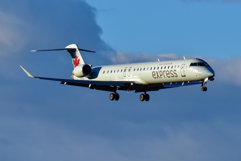 Bombardier CRJ 705 on a sunset final approach