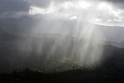 Heavy, localized downpour hits a green valley on the island of Kauai, Hawaii.