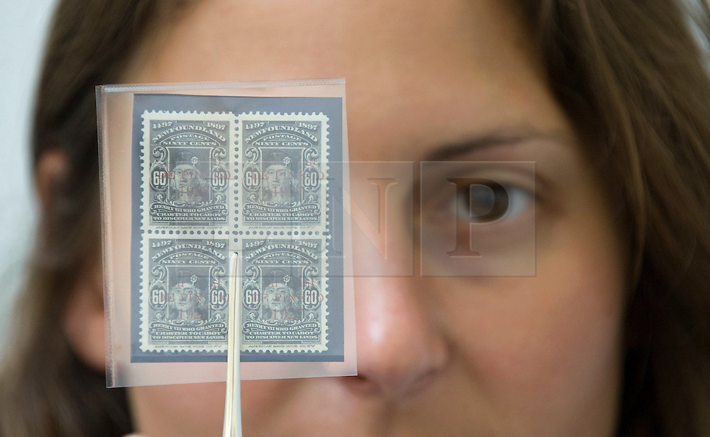 © Licensed to London News Pictures. 01/09/2011. London, UK. A Sotheby's worker holding A unique mint block of De Pinedo Air Mail 60c black stamps  estimated to fetch £120,000 to £150,000 at a Sotheby's sale of The Philatelic Collection of Lord Steinberg on September 6-8 2011. The whole collection is expected to fetch in the region of £4 million. Photo credit: Ben Cawthra/LNP