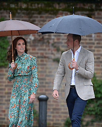 The Duke and Duchess of Cambridge arrive for a visit to the White Garden in Kensington Palace, London and to meet with representatives from charities supported by Diana, the Princess of Wales.