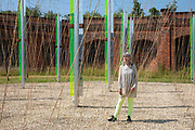 Artist Jyll Bradley with her installation Green/Light part of the Folkestone Triennial launch on 20th of July 2021, in Folkestone, United Kingdom. For Folkestone Triennial 2014, Bradley presentedGreen/Light for M.R., a major sculptural light installation created for the former gasworks site on the junction of Ship Street and Foord Road North, Folkestone. Now derelict, the site was once a hub of energy and the place where light was first generated for the town. The creation of the installation was an intense personal journey for Bradley, who was born in Folkestone in the same year that the gasworks were decommissioned, but has lived her adult life as a successful artist in London.Since its creation, Green/Light For M.R. has become a highly acclaimed work and much-loved local beacon. Its reflective, exciting presence acts as a powerful catalyst for conversations on the future of the gasworks. The artwork is part of the Creative Folkestone Triennial 2020, The Plot, which sees 27 newly commissioned artworks appearing around the south coast seaside town. The new work builds on the work from previous triennials making Folkestone the biggest urban outdoor contemporary art exhibition in the UK.