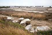 Working quarry and new housing built with local stone, Isle of Portland, Dorset, England