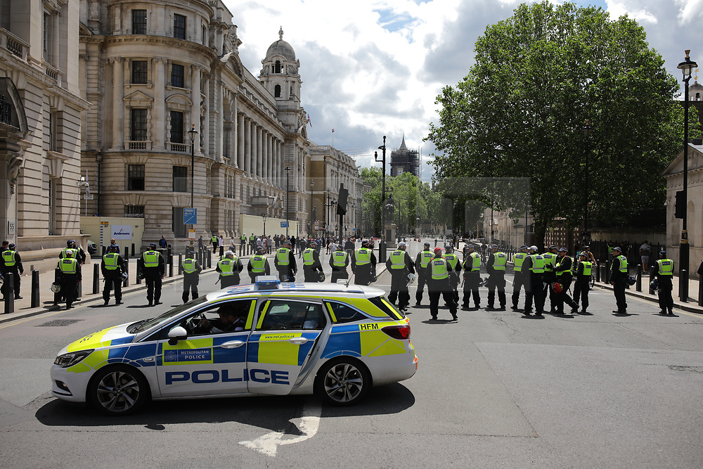 © Licensed to London News Pictures. 13/06/2020. London, UK. Police officers form a blockade on Whitehall as right-wing demonstrators attempt to reach Trafalgar Square, ahead of a planned Black Lives Matter demonstration. Protests have taken place across the United States and in cities around the world in response to the killing of George Floyd by police officers in Minneapolis on 25 May. Photo credit: Rob Pinney/LNP