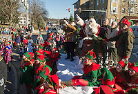 Santa and Mrs. Claus along with Ed Darling, Fred Caruso, Bob Hamel, Ed Engler and Armand Bolduc countdown for the lighting of the Christmas tree in Veteran's Square following the annual Holiday parade downtown Saturday morning.  (Karen Bobotas/for the Laconia Daily Sun)