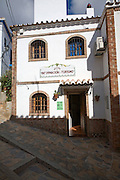 Tourist information building and alleyways in the Andalusian village of Comares, Malaga province, Spain