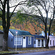 Autumn in Arrowtown. Historic Cottages at the end of town. .Arrowtown is the much visited, historic, 4-season, southern hemisphere holiday destination, located only 20 minutes drive from Queenstown, South Island, New Zealand..Arrowtown is a former gold-mining town built on the banks of the Arrow River, once a rich source of gold in the 1860's and now a sophisticated, multi-cultural town catering visitors from around the globe. Arrowtown offers an ambiance with its shops, restaurants, cafes, offices and galleries located within a tight precinct.  5th April 2011.  Photo Tim Clayton.