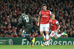 LONDON, ENGLAND - Oct 01: Napoli's defender Camilo Zuniga from Columbia and Arsenal's forward Olivier Giroud from France  compete for the ball during the UEFA Champions League match between Arsenal from England and Napoli from Italy played at The Emirates Stadium, on October 01, 2013 in London, England. (Photo by Mitchell Gunn/ESPA)