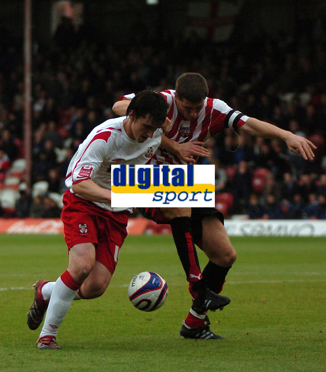 Photo: Tony Oudot.<br /> Brentford v Lincoln City. Coca Cola League 2. 27/10/2007.<br /> Louis Dodds of Lincoln beats John Mackie of Brentford to the ball