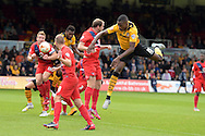 Aaron Hayden of Newport county ® jumps but misses the ball.Skybet football league two match, Newport county v York city at Rodney Parade in Newport, South Wales on Saturday 5th Sept 2015.  pic by Andrew Orchard, Andrew Orchard sports photography.