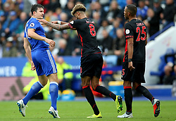 Huddersfield Town's Philip Billing (centre) pushes Leicester City's Harry Maguire during the Premier League match at the King Power Stadium, Leicester.