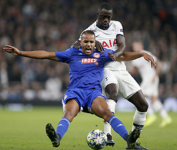 LONDON, Nov. 27, 2019  Tottenham Hotspur's Davinson Sanchez (R) vies with Olympiakos' Youssef El Arabi during the UEFA Champions League Group B match at the Tottenham Hotspur Stadium in London, Britain on Nov. 26, 2019..FOR EDITORIAL USE ONLY. NOT FOR SALE FOR MARKETING OR ADVERTISING CAMPAIGNS. NO USE WITH UNAUTHORIZED AUDIO, VIDEO, DATA, FIXTURE LISTS, CLUB/LEAGUE LOGOS OR ''LIVE'' SERVICES. ONLINE IN-MATCH USE LIMITED TO 45 IMAGES, NO VIDEO EMULATION. NO USE IN BETTING, GAMES OR SINGLE CLUB/LEAGUE/PLAYER PUBLICATIONS. (Photo by Matthew Impey/Xinhua) (Credit Image: © Han Yan/Xinhua via ZUMA Wire)