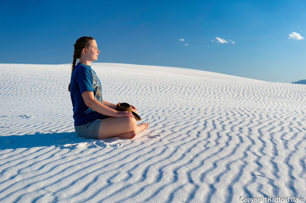 Woman doing yoga at White Sands National Park, New Mexico
