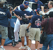 MORNING JOURNAL/DAVID RICHARD<br />Cleveland closer Bob Wickman spent several minutes after the game to hand out baseball to fans and to give hand shakes and hugs to members of the staff and grounds crew.