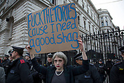 Protester dressed up as Prime Minister Theresa May holds up a crude sign National Union of Students (NUS) and the University and College Union (UCU) demonstration 'United For Education' calling for free, accessible and quality further and higher education across the UK, and to demand an end to the marketisation of university and college education on 19th November 2016 in London, United Kingdom. (photo by Mike Kemp/In Pictures via Getty Images)