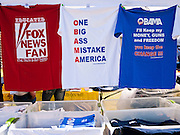 15 APRIL 2011 - PHOENIX, AZ:  Tea Party tee shirts for sale at the Arizona State Capitol Friday. About 500 supporters of the Tea Party movement rallied Friday at the Arizona State Capitol to mark tax day. They protested high taxes, the federal deficit, the debt limit and immigration policy. About 50 pro-immigrant protesters held a counter rally at the capitol. At least one person was arrested, and others led away by police after several shouting matches between Tea Party supporters and the immigrants rights protesters broke out.     Photo by Jack Kurtz