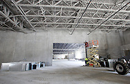 Work continues in the maintenance area of the new Coach USA garage and headquarters under construction in Chester on Monday, Sept. 16, 2013.