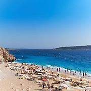 People swim and sunbathe on Kaputas beach, turquoise beach, Turkey