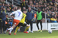 Burton Albion defender Reece Hutchinson (19) and Luton Town midfielder Jack Stacey (7) during the EFL Sky Bet League 1 match between Burton Albion and Luton Town at the Pirelli Stadium, Burton upon Trent, England on 27 April 2019.