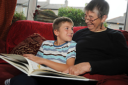 A granny reads with her grandson. MODEL RELEASED