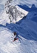 Jim Zellers and Tom Burt on the summit of Taku Tower preparing to descend. Taku Tower, Juneau Icefields, Alaska