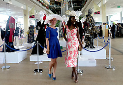 Female racegoers pose for photographers during day two of Royal Ascot at Ascot Racecourse.