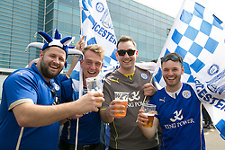 © Licensed to London News Pictures. 07/05/2016. Leicester, UK. Leicester City fans celebrating outside the King Power stadium before their match with Everton before lifting the Premiership trophy. Pictured, fans celebrating. Photo credit: Dave Warren/LNP