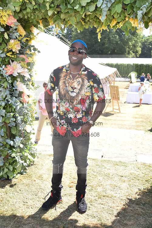 Tinie Tempah at the 'Cartier Style et Luxe' enclosure during the Goodwood Festival of Speed, Goodwood House, West Sussex, England. 15 July 2018.