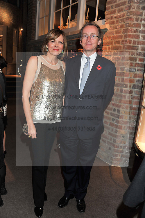 The EARL & COUNTESS OF WOOLTON at a party to celebrate the launch of Carol Woolton's book 'Drawing Jewels For Fashion' held at Asprey, 167 New Bond Street, London W1 on 10th November 2011.