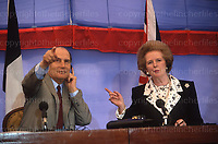 British Prime Minister Margaret Thatcher with French President Mitterrand at a press conference at Waddeston Manor, UK in May 1990. Photograph by Terry Fincher