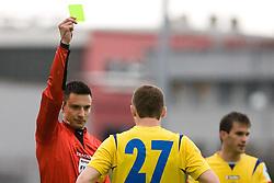 Damir Hadzic of Koper (R) and referee Slavko Vincic with yellow card  at 34th Round of 1st Slovenian Football League match between NK Olimpija and NK Luka Koper, on May 5, 2010, in ZAK, Ljubljana, Slovenia.  (Photo by Vid Ponikvar / Sportida)