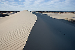 Dune, sky and campground, Monahans Sandhills State Park, Texas, USA.