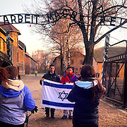 "Students doing a photograph under the sign ""Arbeit macht frei"" at the entrance to the Auschwitz Nazi concentration camp. #concentrationcamp #kz #krakow #poland #nazi #politics #history #thirdreich #konzentrationslager #history #memorial #documentary #neverforget #evidence #latergram #genocide #jewishflag"