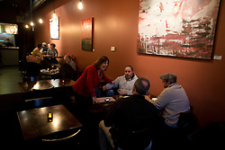 Cheri Sprenger, center, owner of Pour Wine Bar and Bistro, chats up customers at her venue in the Montclair district of Oakland, Calif., Wednesday, Dec. 23, 2015. (Photo by D. Ross Cameron)
