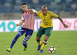 20112018 (Durban)<br /> Dino Ndlovu tackles a ball during a match were Bafana Bafana and Paraguay have drawn 1-1 in the Nelson Mandela Challenge match played at Moses Mabhida Stadium in Durban on Tuesday evening.<br /> Picture: Motshwari Mofokeng/African News Agency (ANA)
