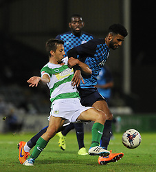 QPR's Oscar Gobern is tackled by Yeovil Town's Wes Fogden - Photo mandatory by-line: Harry Trump/JMP - Mobile: 07966 386802 - 11/08/15 - SPORT - FOOTBALL - Capital One Cup - First Round - Yeovil Town v QPR - Huish Park, Yeovil, England.