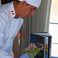 South America, Peru, Amazon.  On the m/v Aria, the chef teaches a class on preparing Peruvian ceviche.