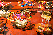 Traditional ornate Mardi Gras masks, souvenirs and gifts in shop in Royal Street, French Quarter of New Orleans, USA