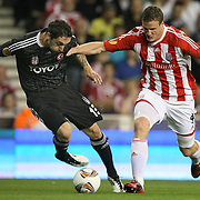 Besiktas's Roberto HILBERT (L) and Stoke's Robert HUTH (R) during their UEFA Europa League Group E soccer match Besiktas between Stoke at Stoke Stadium in Stoke-on-Trent City England on Thursday September 29, 2011. Photo by TURKPIX