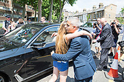 London Mayor, Sadiq Khan hugs young Charlene Nolan out St Clement's Church on Treadgold Street in Notting Dale after family attended church service with family and siblings on the 18th June 2017 in North Kensington, London, United Kingdom. The Grenfell Tower fire occurred on 14 June 2017 at the 24-storey Grenfell Tower block of public housing flats in North Kensington, Royal Borough of Kensington and Chelsea, West London. St Clements Church is located on Treadgold Street in Notting Dale, serving areas of Notting Hill, North Kensington, Ladbroke Grove and Portobello Road.