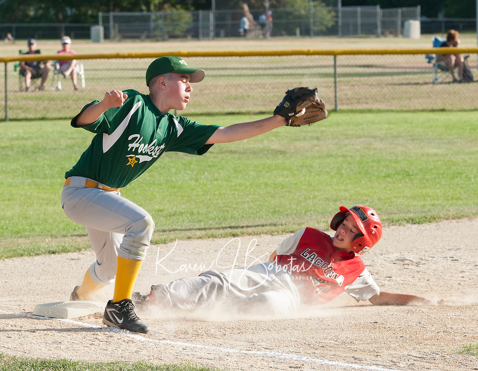 Laconia's Brad Weeks slides into third ahead of the tag by Hooksett's Connor Jenkins  during the Laconia Little League 11/12 All Star game Monday night at Colby Field.  (Karen Bobotas/for the Laconia Daily Sun)