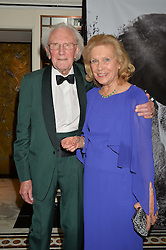 Artist DAVID SHEPHERD and his wife AVRIL at the David Shepherd Wildlife Foundation 30th anniversary Wildlife Ball at The Dorchester, Park Lane, London on 10th October 2014.