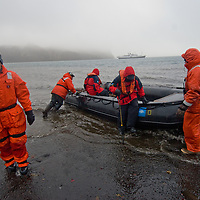 Guides from the National Geographic Endeavor use a Zodiac raft to ferry passengers back to the ship from Whaler's Bay on Deception Island, an active caldera in Antarctica.