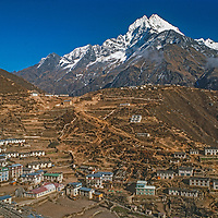 Mount Thamserku overlooks Namche Bazar, the leading town of the Sherpas and Khumbu Region of Nepal. This was shot in 1986 as tourism was just beginning to moderneize and reshape the architecture.