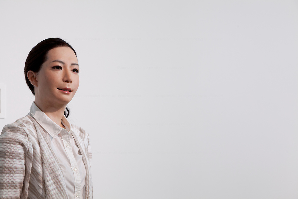 Profile portraits of Otonaroid lifelike robot at Miraiken Science Museum, Odaiba, Tokyo. Japan. Friday June 27th 2014. Created by Osaka robotics professor, Hiroshi Ishiguro the remotely-controlled android tests people interact with androids.