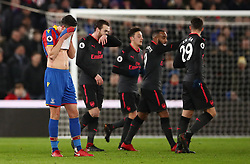 Crystal Palace's Martin Kelly (left) stands dejected after Arsenal's Shkodran Mustafi scored his side's first goal of the game during the Premier League match at Selhurst Park, London.