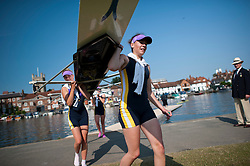 © London News Pictures. 05/07/2012.  Henley-on-Thames, UK. A female rowers Eton Excelsior Club leave the water after a race  on Day three of Henley Royal Regatta on the River Thames at Henley-on-Thames, Oxfordshire on July 03, 2013. The 5 day regatta over the first weekend in July, races head-to-head knock out competitions over a course of 1 mile between rowing teams from throughout the world. Photo credit: Ben Cawthra/LNP