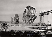 Forth Railway Bridge from South-East, c1890, Scotland. The partly built bridge viewed from the West, October 1888.This bridge, built for the North British Railway Company, was begun in 1882 and opened on 4 March 1890. Benjamin Baker (1840-1907) the engineer. William Arrol (1839-1913) the principal contractor. The steel for the girders was produced the by the Siemens-Martin process. Photograph.