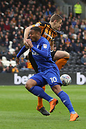 Cardiff City forward Kenneth Zohore (10) and Hull City defender Michael Dawson (21) battles for possession  during the EFL Sky Bet Championship match between Hull City and Cardiff City at the KCOM Stadium, Kingston upon Hull, England on 28 April 2018. Picture by Mick Atkins.