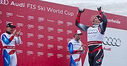 19.03.2011, Pista Silvano Beltrametti, Lenzerheide, SUI, FIS Ski Worldcup, Finale, Lenzerheide, Slalom Herren, im Bild Gesamtweltcup Sieger, Ivica Kostelic (CRO) jubelt, der zweit platzierte Didier Cuche (SUI) und der dritte Carlo Janka (SUI) schauen zu ihm im Zielraum auf der Lenzerheide. //  Overall World Cup champion Ivica Kostelic (CRO) cheers, the second-place Didier Cuche (SUI) and the third Carlo Janka (SUI) look at him during Men´s Downhill, at Pista Silvano Beltrametti, in Lenzerheide, Switzerland, 18/03/2011, EXPA Pictures © 2011, PhotoCredit: EXPA/ J. Feichter